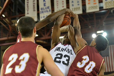 November 28, 2013: Harvard Crimson guard/forward Wesley Saunders (23) has a shot blocked by Denver Pioneers guard Cam Griffin (30) in a first round game at the 2013 Great Alaska Shootout between Harvard and Denver.  Harvard defeated Denver 68-60. Harvard defeated Denver 68-60.
