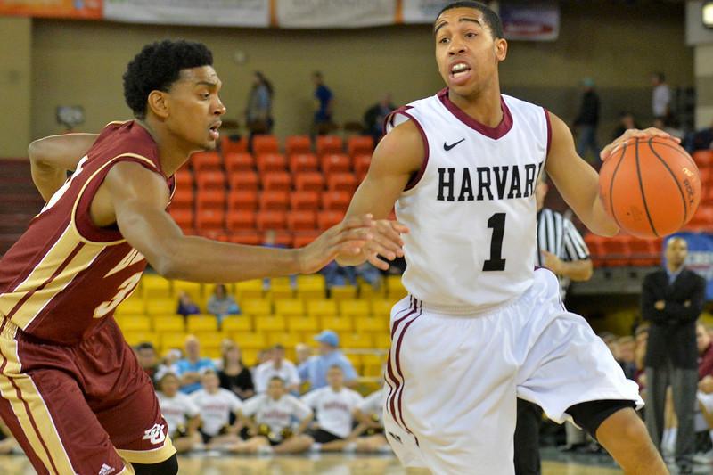 November 28, 2013: Harvard Crimson guard Siyani Chambers (1) drives to the basket in a first round game at the 2013 Great Alaska Shootout between Harvard and Denver.  Harvard defeated Denver 68-60. Harvard defeated Denver 68-60.