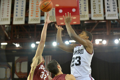 November 28, 2013: Denver Pioneers forward Drick Bernstine (32) blocks a shot attempt by Harvard Crimson guard/forward Wesley Saunders (23) in a first round game at the 2013 Great Alaska Shootout between Harvard and Denver.  Harvard defeated Denver 68-60. Harvard defeated Denver 68-60.