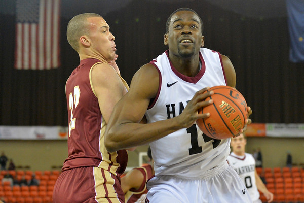 November 28, 2013: Harvard Crimson forward Steve Moundou-Missi (14) drives past Denver Pioneers forward Drick Bernstine (32) in a first round game at the 2013 Great Alaska Shootout between Harvard and Denver.  Harvard defeated Denver 68-60. Harvard defeated Denver 68-60.