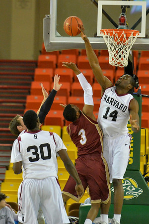 November 28, 2013: Harvard Crimson forward Steve Moundou-Missi (14) blocks a shot attempt by Denver Pioneers guard Jalen Love (3) in a first round game at the 2013 Great Alaska Shootout between Harvard and Denver.  Harvard defeated Denver 68-60. Harvard defeated Denver 68-60.