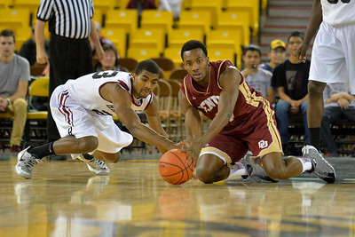 November 28, 2013: A Harvard Crimson and Denver Pioneers player battle for a loose ball in a first round game at the 2013 Great Alaska Shootout between Harvard and Denver.  Harvard defeated Denver 68-60. Harvard defeated Denver 68-60.