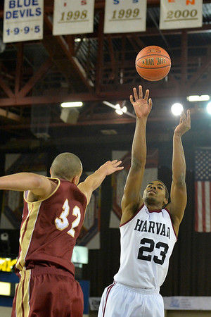 November 28, 2013: Harvard Crimson guard/forward Wesley Saunders (23) shoots over Denver Pioneers forward Drick Bernstine (32) in a first round game at the 2013 Great Alaska Shootout between Harvard and Denver.  Harvard defeated Denver 68-60. Harvard defeated Denver 68-60.