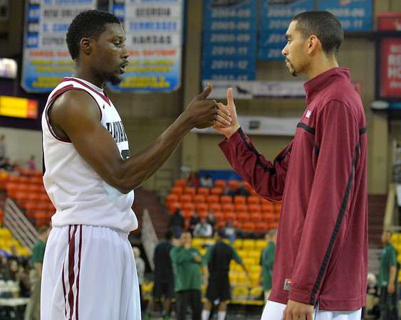 November 29, 2013: A pair of Harvard Crimson players perform their pregame routine before a semifinal game at the 2013 Great Alaska Shootout between Harvard and Green Bay. Harvard defeated Green Bay 76-64.