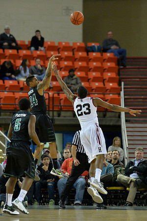 November 29, 2013: Green Bay Phoenix guard Keifer Sykes (24) shoots a three over Harvard Crimson guard/forward Wesley Saunders (23) in a semifinal game at the 2013 Great Alaska Shootout between Harvard and Green Bay. Harvard defeated Green Bay 76-64.