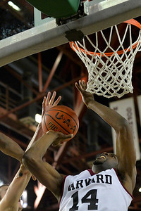 November 29, 2013: Harvard Crimson forward Steve Moundou-Missi (14) puts up a shot in a semifinal game at the 2013 Great Alaska Shootout between Harvard and Green Bay. Harvard defeated Green Bay 76-64.