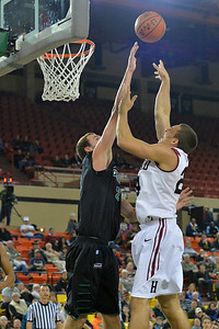 November 29, 2013: Green Bay Phoenix forward/center Alec Brown (21) contests a shot from Harvard Crimson forward Jonah Travis (24) in a semifinal game at the 2013 Great Alaska Shootout between Harvard and Green Bay. Harvard defeated Green Bay 76-64.