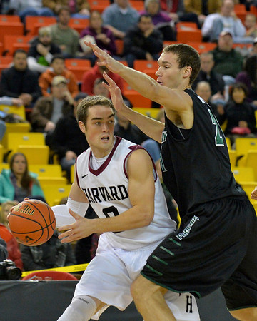 November 29, 2013: Harvard Crimson guard Laurent Rivard (0) looks to pass to a teammate in a semifinal game at the 2013 Great Alaska Shootout between Harvard and Green Bay. Harvard defeated Green Bay 76-64.