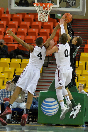 November 29, 2013: Green Bay Phoenix forward Kenneth Lowe (45) has a shot blocked by a pair of Harvard Crimson defenders in a semifinal game at the 2013 Great Alaska Shootout between Harvard and Green Bay. Harvard defeated Green Bay 76-64.