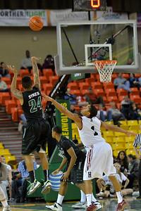 November 29, 2013: Green Bay Phoenix guard Keifer Sykes (24) shoots over Harvard Crimson guard Siyani Chambers (1) in a semifinal game at the 2013 Great Alaska Shootout between Harvard and Green Bay. Harvard defeated Green Bay 76-64.