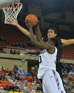 November 29, 2013: Green Bay Phoenix guard/forward Jordan Fouse (4) contests a layup attempt by Harvard Crimson forward Kyle Casey (30) in a semifinal game at the 2013 Great Alaska Shootout between Harvard and Green Bay. Harvard defeated Green Bay 76-64.