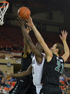 November 29, 2013: Harvard Crimson forward Kyle Casey (30) puts up a shot between a pair of Green Bay Phoenix defenders in a semifinal game at the 2013 Great Alaska Shootout between Harvard and Green Bay. Harvard defeated Green Bay 76-64.