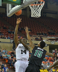 November 29, 2013: Harvard Crimson forward Steve Moundou-Missi (14) puts up a shot over Green Bay Phoenix forward Greg Mays (15)] in a semifinal game at the 2013 Great Alaska Shootout between Harvard and Green Bay. Harvard defeated Green Bay 76-64.