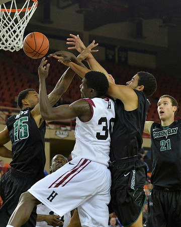 November 29, 2013: Green Bay Phoenix players battle Harvard Crimson forward Kyle Casey (30) for a rebound in a semifinal game at the 2013 Great Alaska Shootout between Harvard and Green Bay. Harvard defeated Green Bay 76-64.