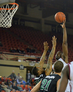 November 29, 2013: Harvard Crimson forward Steve Moundou-Missi (14) puts up a shot over a Green Bay Phoenix defender in a semifinal game at the 2013 Great Alaska Shootout between Harvard and Green Bay. Harvard defeated Green Bay 76-64.