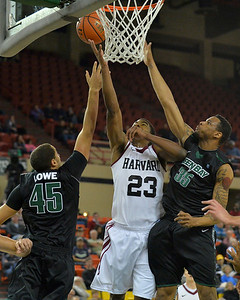 November 29, 2013: Harvard Crimson guard/forward Wesley Saunders (23) puts up a layup in a semifinal game at the 2013 Great Alaska Shootout between Harvard and Green Bay. Harvard defeated Green Bay 76-64.