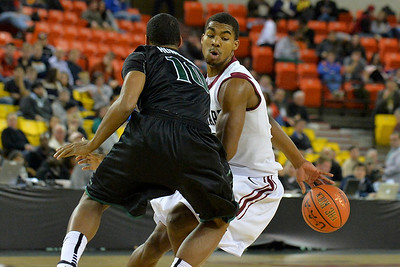 November 29, 2013: Harvard Crimson guard/forward Wesley Saunders (23) dribbles behind his back around Green Bay Phoenix guard/forward Josh Humphrey (10) in a semifinal game at the 2013 Great Alaska Shootout between Harvard and Green Bay. Harvard defeated Green Bay 76-64.