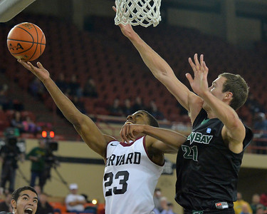 November 29, 2013: Harvard Crimson guard/forward Wesley Saunders (23) drives past Green Bay Phoenix forward/center Alec Brown (21) for a layup in a semifinal game at the 2013 Great Alaska Shootout between Harvard and Green Bay. Harvard defeated Green Bay 76-64.