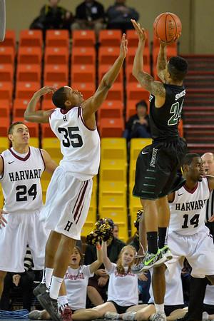 November 29, 2013: Green Bay Phoenix guard Keifer Sykes (24) shoots over Harvard Crimson guard/forward Agunwa Okolie (35) in a semifinal game at the 2013 Great Alaska Shootout between Harvard and Green Bay. Harvard defeated Green Bay 76-64.