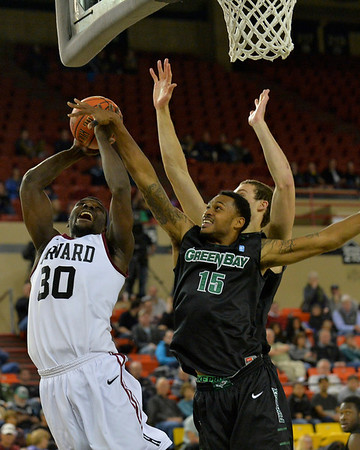 November 29, 2013: Green Bay Phoenix forward Greg Mays (15) blocks a shot attempt from Harvard Crimson forward Kyle Casey (30) in a semifinal game at the 2013 Great Alaska Shootout between Harvard and Green Bay. Harvard defeated Green Bay 76-64.