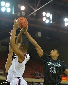 November 29, 2013: Green Bay Phoenix guard/forward Josh Humphrey (10) contests a Harvard Crimson shot in a semifinal game at the 2013 Great Alaska Shootout between Harvard and Green Bay. Harvard defeated Green Bay 76-64.
