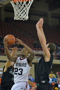 November 29, 2013: Harvard Crimson guard/forward Wesley Saunders (23) drives to the basket for a layup in a semifinal game at the 2013 Great Alaska Shootout between Harvard and Green Bay. Harvard defeated Green Bay 76-64.