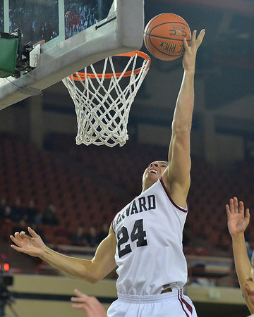 November 29, 2013: Harvard Crimson forward Jonah Travis (24) puts up a layup in a semifinal game at the 2013 Great Alaska Shootout between Harvard and Green Bay. Harvard defeated Green Bay 76-64.