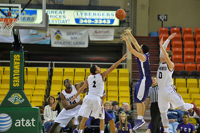 November 30, 2013: Harvard Crimson guard Siyani Chambers (1) defends a TCU Horned Frogs shot attempt in the championship game of the 2013 Great Alaska Shootout between Harvard and TCU. Harvard defeated TCU 71-50.