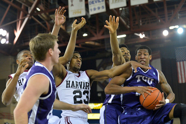 November 30, 2013: Harvard Crimson and TCU Horned Frogs players battle for a rebound in the championship game of the 2013 Great Alaska Shootout between Harvard and TCU. Harvard defeated TCU 71-50.