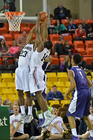 November 30, 2013: Harvard Crimson players grab a rebound in the championship game of the 2013 Great Alaska Shootout between Harvard and TCU. Harvard defeated TCU 71-50.
