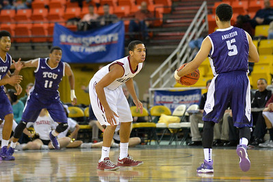 November 30, 2013: Harvard Crimson guard Siyani Chambers (1) gets set on defense as TCU Horned Frogs guard Kyan Anderson (5) brings the ball up the floor in the championship game of the 2013 Great Alaska Shootout between Harvard and TCU. Harvard defeated TCU 71-50.