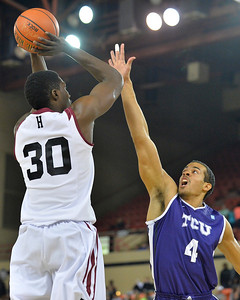 November 30, 2013: TCU Horned Frogs forward Amric Fields (4) contests a shot attempt from Harvard Crimson forward Kyle Casey (30) in the championship game of the 2013 Great Alaska Shootout between Harvard and TCU. Harvard defeated TCU 71-50.