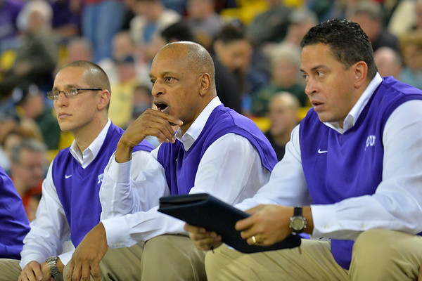 November 30, 2013: The TCU Horned Frogs coaching staff watches the action in the championship game of the 2013 Great Alaska Shootout between Harvard and TCU. Harvard defeated TCU 71-50.