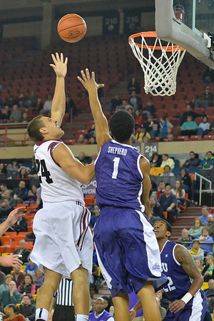 November 30, 2013: Harvard Crimson forward Jonah Travis (24) puts up a shot over TCU Horned Frogs center Karviar Shepherd (1) in the championship game of the 2013 Great Alaska Shootout between Harvard and TCU. Harvard defeated TCU 71-50.