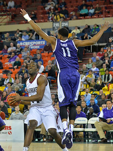 November 30, 2013: TCU Horned Frogs forward Brandon Parrish (11) leaps toward Harvard Crimson forward Steve Moundou-Missi (14) in the championship game of the 2013 Great Alaska Shootout between Harvard and TCU. Harvard defeated TCU 71-50.