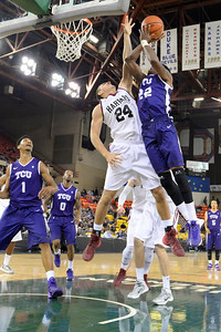 November 30, 2013: TCU Horned Frogs guard Jarvis Ray (22) takes a contested shot over Harvard Crimson forward Jonah Travis (24) in the championship game of the 2013 Great Alaska Shootout between Harvard and TCU. Harvard defeated TCU 71-50.