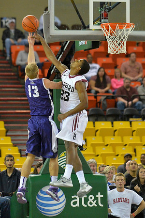 November 30, 2013: Harvard Crimson guard/forward Wesley Saunders (23) blocks a shot attempt from TCU Horned Frogs guard Christian Gore (13) in the championship game of the 2013 Great Alaska Shootout between Harvard and TCU. Harvard defeated TCU 71-50.