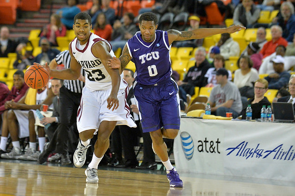 November 30, 2013: Harvard Crimson guard/forward Wesley Saunders (23) brings the ball up the court against a TCU Horned Frogs defender in the championship game of the 2013 Great Alaska Shootout between Harvard and TCU. Harvard defeated TCU 71-50.