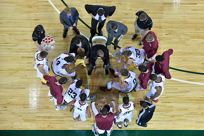 November 30, 2013: Harvard Crimson head coach Tommy Amaker talks to his team during a timeout in the championship game of the 2013 Great Alaska Shootout between Harvard and TCU. Harvard defeated TCU 71-50.