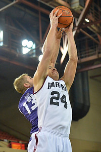 November 30, 2013: Harvard Crimson forward Jonah Travis (24) and TCU Horned Frogs guard Christian Gore (13) battle for a rebound in the championship game of the 2013 Great Alaska Shootout between Harvard and TCU. Harvard defeated TCU 71-50.