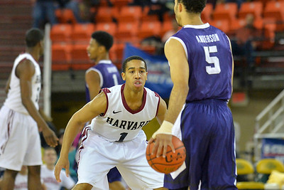 November 30, 2013: Harvard Crimson guard Siyani Chambers (1) gets set on defense in the championship game of the 2013 Great Alaska Shootout between Harvard and TCU. Harvard defeated TCU 71-50.
