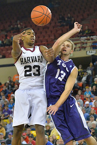 November 30, 2013: Harvard Crimson guard/forward Wesley Saunders (23) kicks the ball out to a teammate in the championship game of the 2013 Great Alaska Shootout between Harvard and TCU. Harvard defeated TCU 71-50.