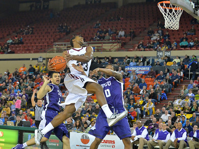 November 30, 2013: Harvard Crimson guard/forward Wesley Saunders (23) drives to the basket in the championship game of the 2013 Great Alaska Shootout between Harvard and TCU. Harvard defeated TCU 71-50.