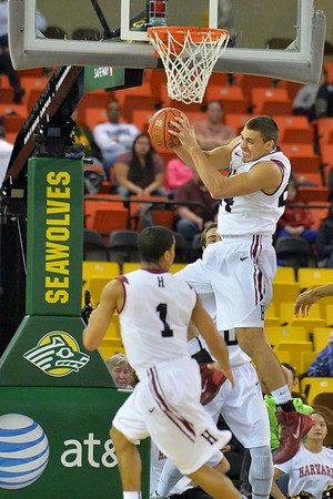 November 30, 2013: Harvard Crimson forward Jonah Travis (24) grabs a rebound in the championship game of the 2013 Great Alaska Shootout between Harvard and TCU. Harvard defeated TCU 71-50.