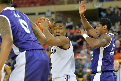 November 30, 2013: Harvard Crimson forward Zena Edosomwan (4) looks to make a move against the TCU Horned Frogs defense in the championship game of the 2013 Great Alaska Shootout between Harvard and TCU. Harvard defeated TCU 71-50.