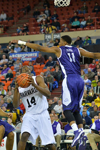 November 30, 2013: Harvard Crimson forward Steve Moundou-Missi (14) looks to take a shot as TCU Horned Frogs forward Brandon Parrish (11) leaps to block the shot in the championship game of the 2013 Great Alaska Shootout between Harvard and TCU. Harvard defeated TCU 71-50.