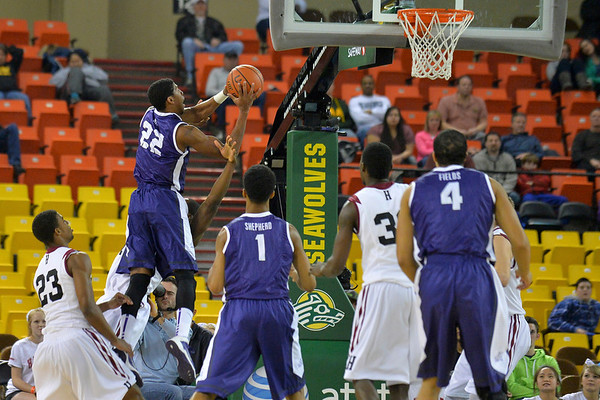 November 30, 2013: TCU Horned Frogs guard Jarvis Ray (22) puts up a shot in the championship game of the 2013 Great Alaska Shootout between Harvard and TCU. Harvard defeated TCU 71-50.