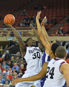 November 30, 2013: Harvard Crimson forward Kyle Casey (30) puts up a shot over a TCU Horned Frogs defender in the championship game of the 2013 Great Alaska Shootout between Harvard and TCU. Harvard defeated TCU 71-50.
