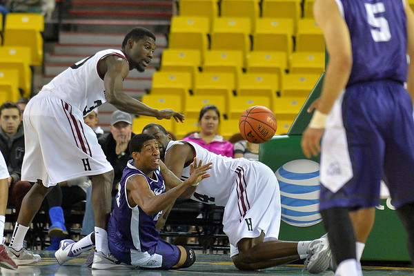 November 30, 2013: TCU Horned Frogs guard Jarvis Ray (22) passes the ball to a teammate after a scramble for the loose ball in the championship game of the 2013 Great Alaska Shootout between Harvard and TCU. Harvard defeated TCU 71-50.