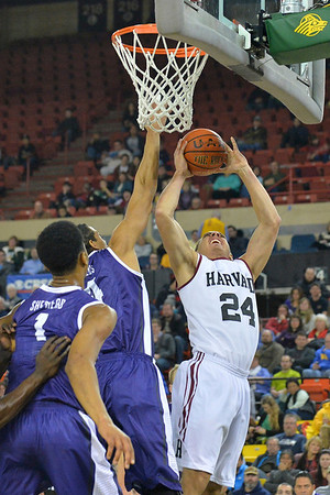 November 30, 2013: Harvard Crimson forward Jonah Travis (24) puts up a shot in the championship game of the 2013 Great Alaska Shootout between Harvard and TCU. Harvard defeated TCU 71-50.